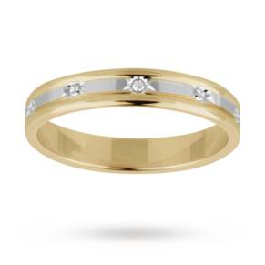 Ladies wedding ring in 18 carat white and yellow gold